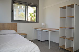 bachelor dorms bed room